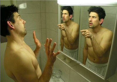 man and mirror